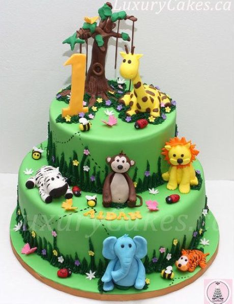 Jungle Themed Cake Bit No Fondant Plastic Animals And Candy - Plastic birthday cake