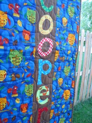 This is the back of the quilt - with the name on it (great idea).  Love the front of it too.