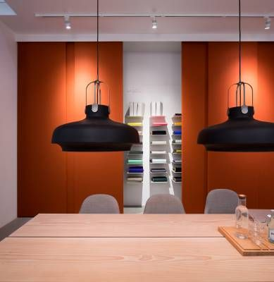 Kvadrat meeting room featuring a table by Dinesen, chairs by Jaime Hayon and lights by Space Copenhagen