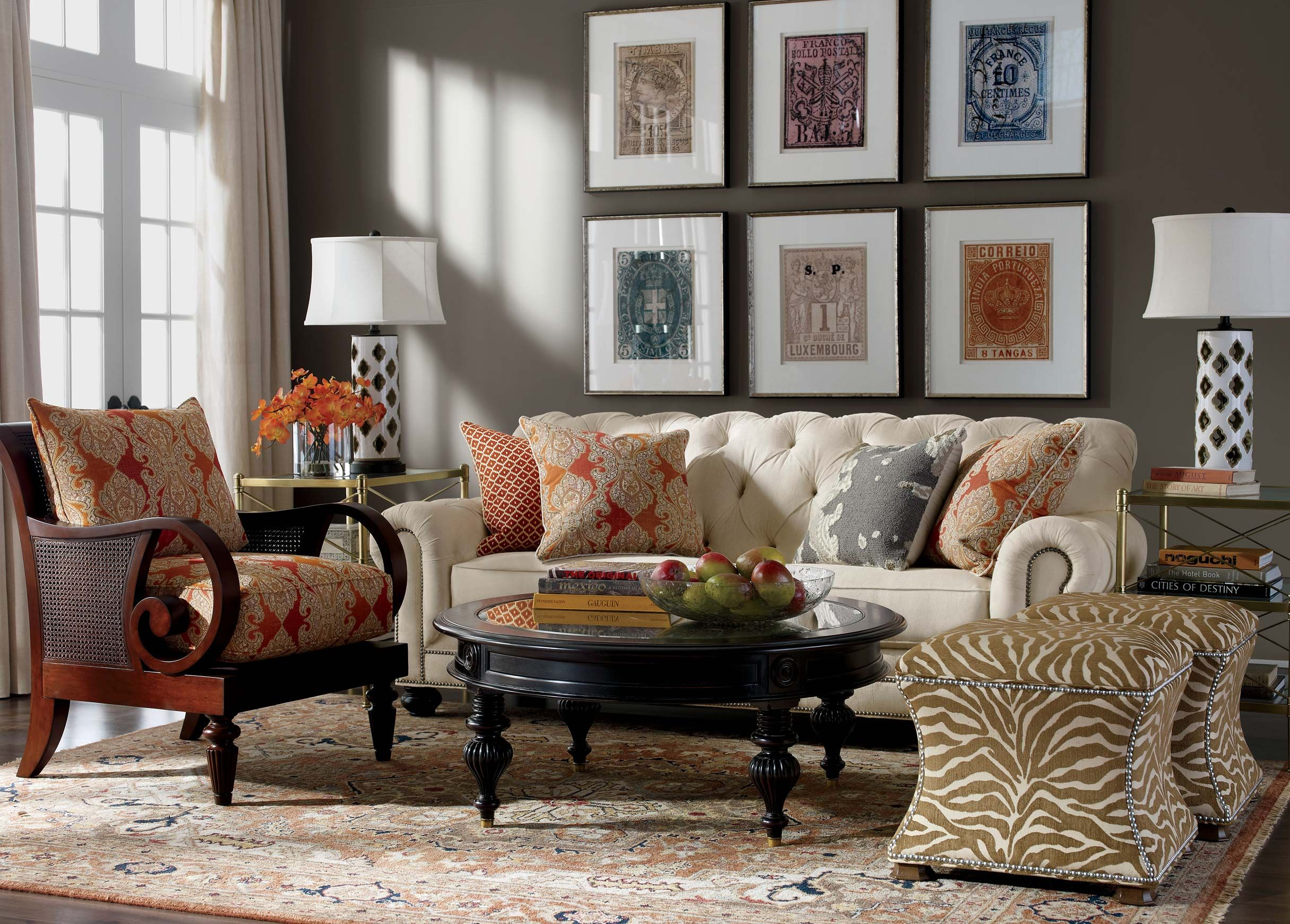 Global Mix Living Room | Ethan Allen | Interior Design | Animal Print  Ottoman | Collecter | Red And Gold | Rust | Accent Wall | Gallery Wall