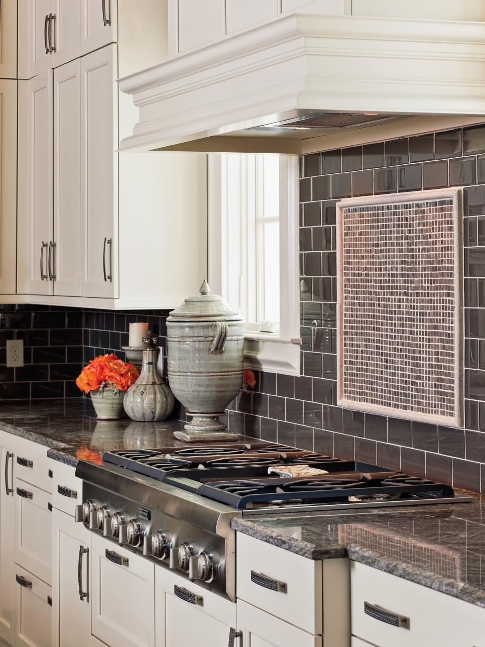 In this beautiful kitchen smoky gray subway tile comes across as