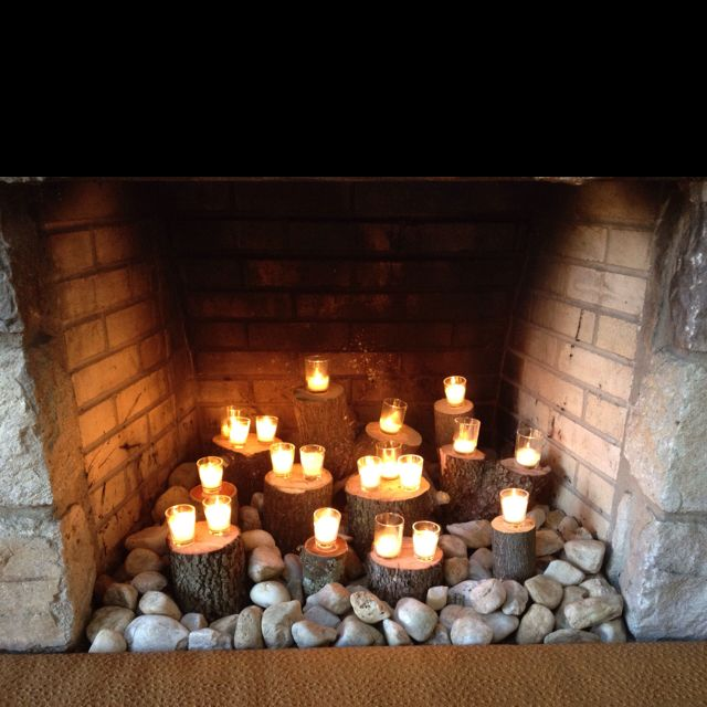 Fireplace Candlescape Using Stumps Votives And River Rock