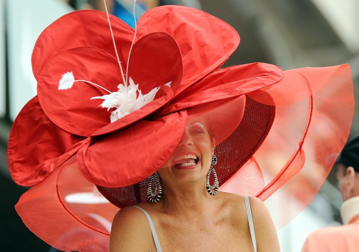 74bde022f32 Never know what you will find at the kentucky derby! This enormous hat has  us seeing red.