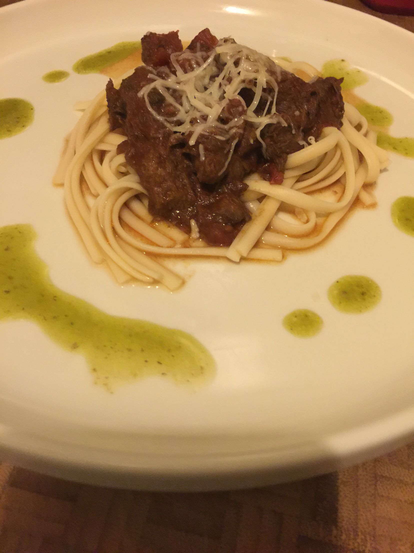 Braised Beef Tongue Ragu with Fettuccini and Basil Oil