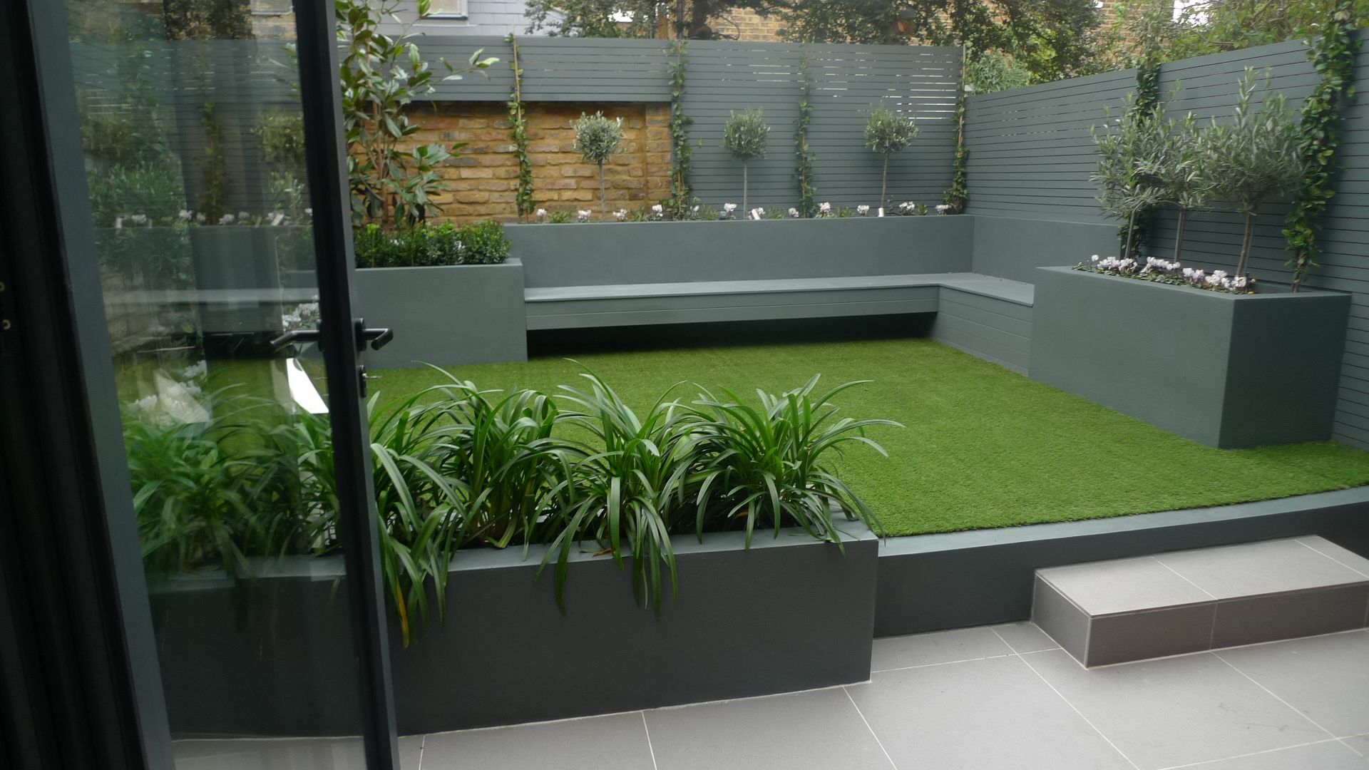 lawn gardencontemporary garden features decor with gree seagrass and l shape laminated grey bench also painted grey wall great small garden feature