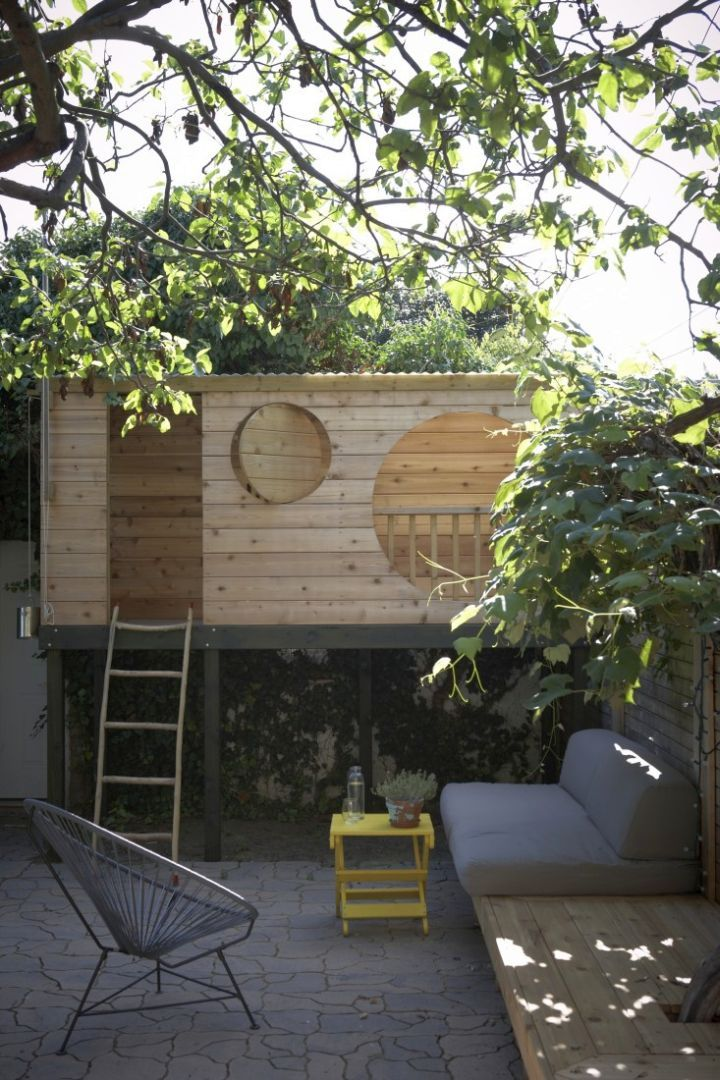 small contemporary treehouse on stilts