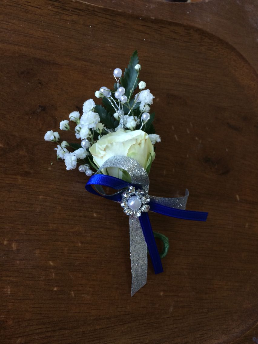 White spray rose with navy blue and silver ribbon prom corsage