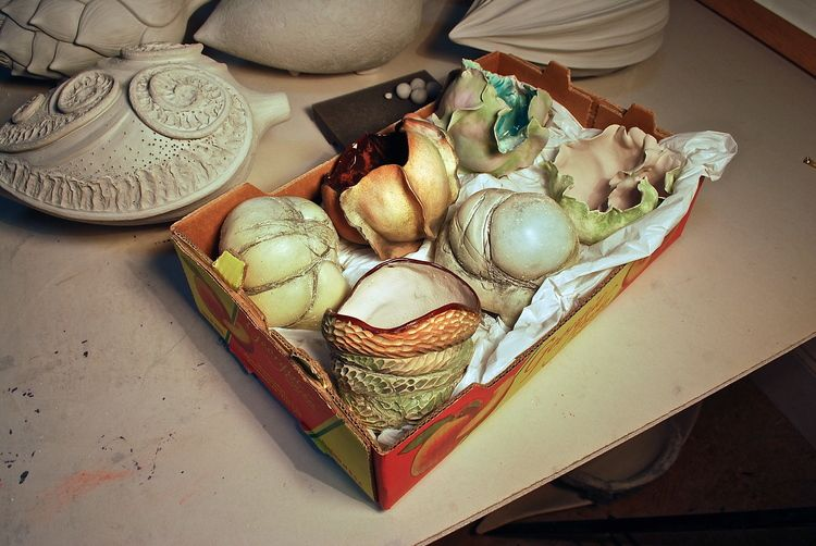 Meditation pieces nesting in a Costco peach box and ready for their 2nd firing
