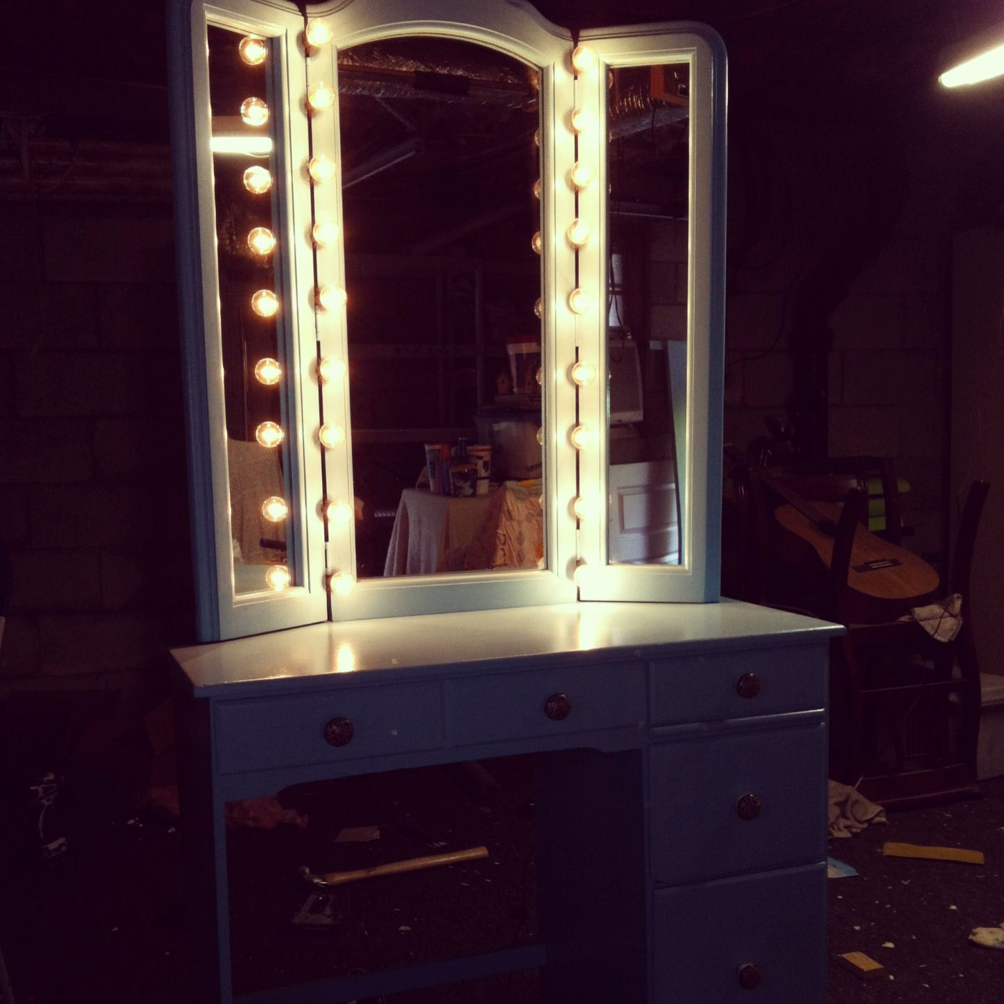 Homemade vanity old desk trifold mirror and outside twinkle