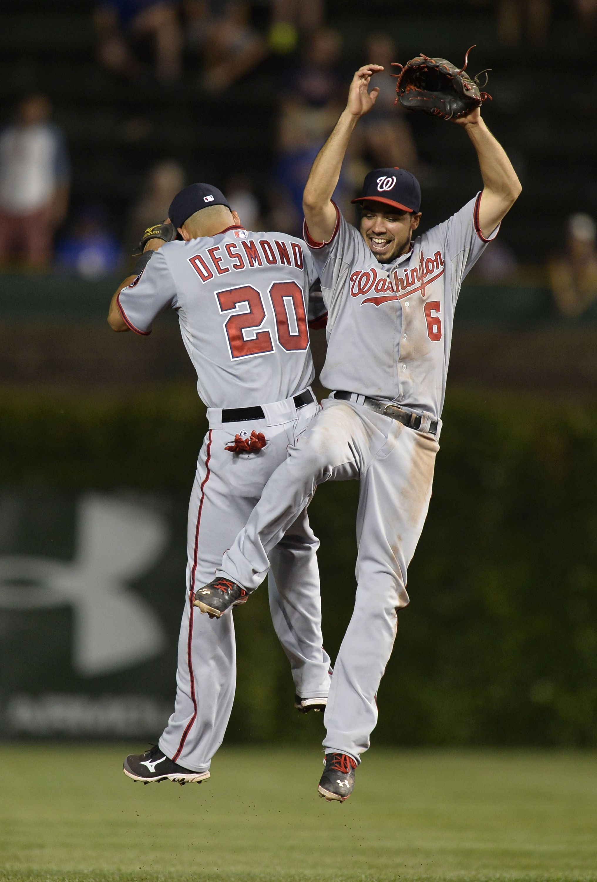 CHICAGO, IL - AUGUST 20: Ian Desmond #20 (L) and Anthony Rendon #6 of the Washington Nationals celebrate after defeating the Chicago Cubs 4-2 at Wrigley Field on August 20, 2013 in Chicago, Illinois. (Photo by Brian Kersey/Getty Images)