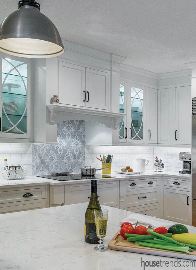 An Elegant Mosaic Tile Focal Point Behind The Range Breaks Up The