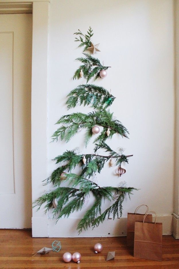 Love This Idea The Tree Can Keep Growing Less Water Needed Fewer Ornaments Needed To Sto Wall Christmas Tree Minimalist Christmas Minimalist Christmas Decor