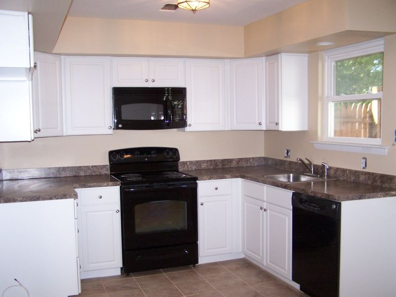 antique white kitchen cabinets with black appliances, kitchens with black appliances new kitchen with white