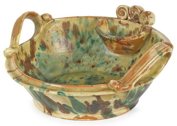 Lot: Shenandoah Valley, Virginia redware wash basin,, Lot Number: 0660, Starting Bid: $1,500, Auctioneer: Pook & Pook, Inc., Auction: Period Furniture, Fine Art & Accessories Sale, Date: April 26th, 2014 EDT