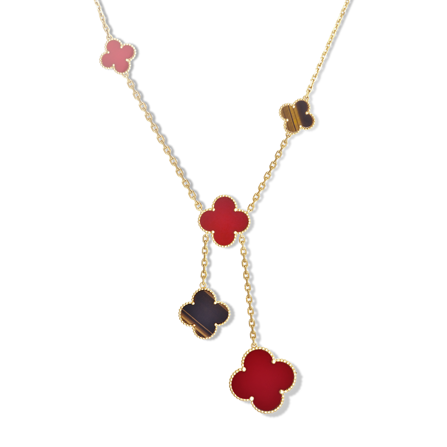 31f141c6c86c This striking necklace glows with tiger s eye and carnelian set in yellow  gold. The Magic Alhambra collection introduces Van Cleef   Arpels  iconic  ...