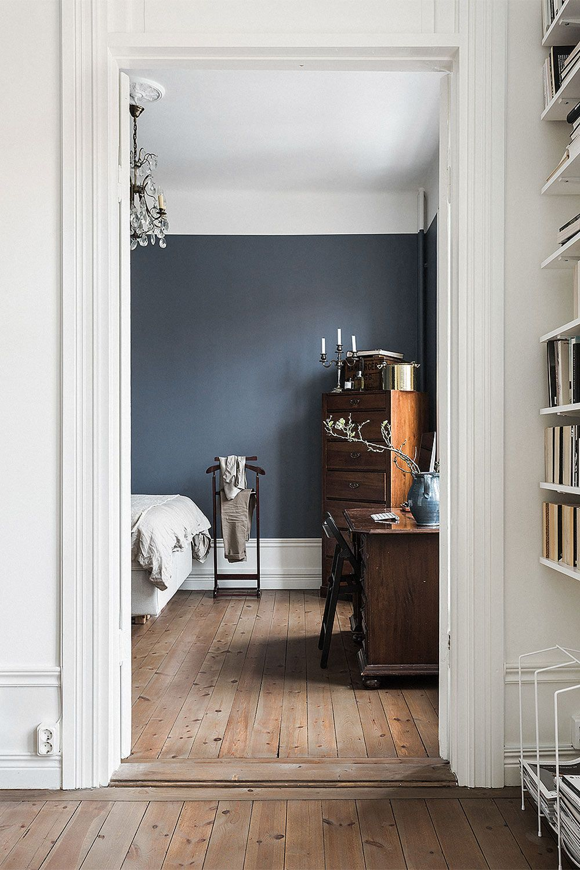 A beautiful contrast between the dark bluish gray of the bedroom and