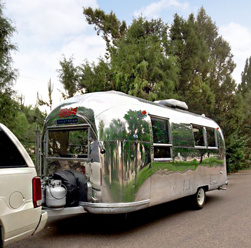 """Designer Susie Johnson of Dragonfly Kitchens had always dreamed of owning a vintage #Airsteam trailer. After over a year and a half, she finally found a classic 1965 Safari Airstream… It was adorable! However, the interior was not as adorable as the exterior… Susie, being a cabinetry designer, instantly started dreaming up plans for her vintage getaway. """"Dura Supreme's Allspice stain was the perfect choice... Read more on Dura Supreme Blog"""