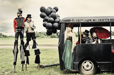 Carnivale Bus--Sweet!! ( but without the mens black makeup) or Black balloons