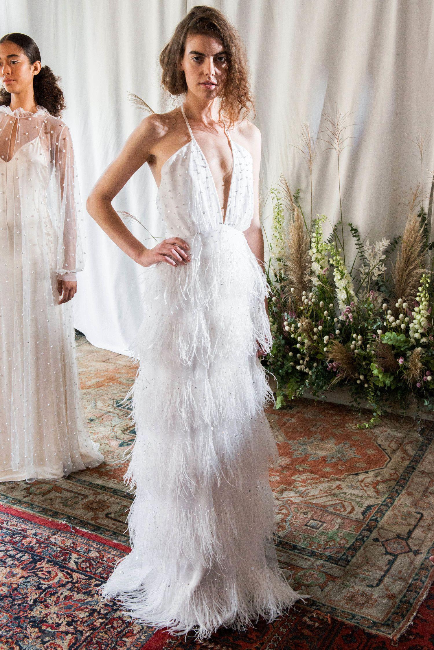 Sheath wedding dress with deep vneckline halter straps tiered