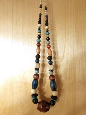 From flea market: wooden necklace.
