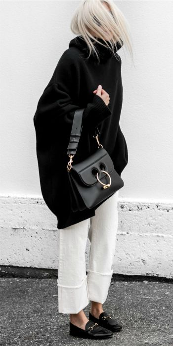 Figtny + vision in head to toe + monochrome + pair of classic black loafers + white culotte trousers + ultimate contrast + 'statement' + white against black + style + edgy street look! Knit: Matches Fashion, Denim: Citizens of Humanity, Bag: J.W Anderson.