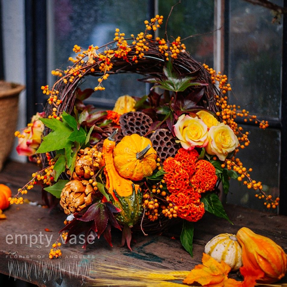 Basket with roses, dried lotus pods, dried