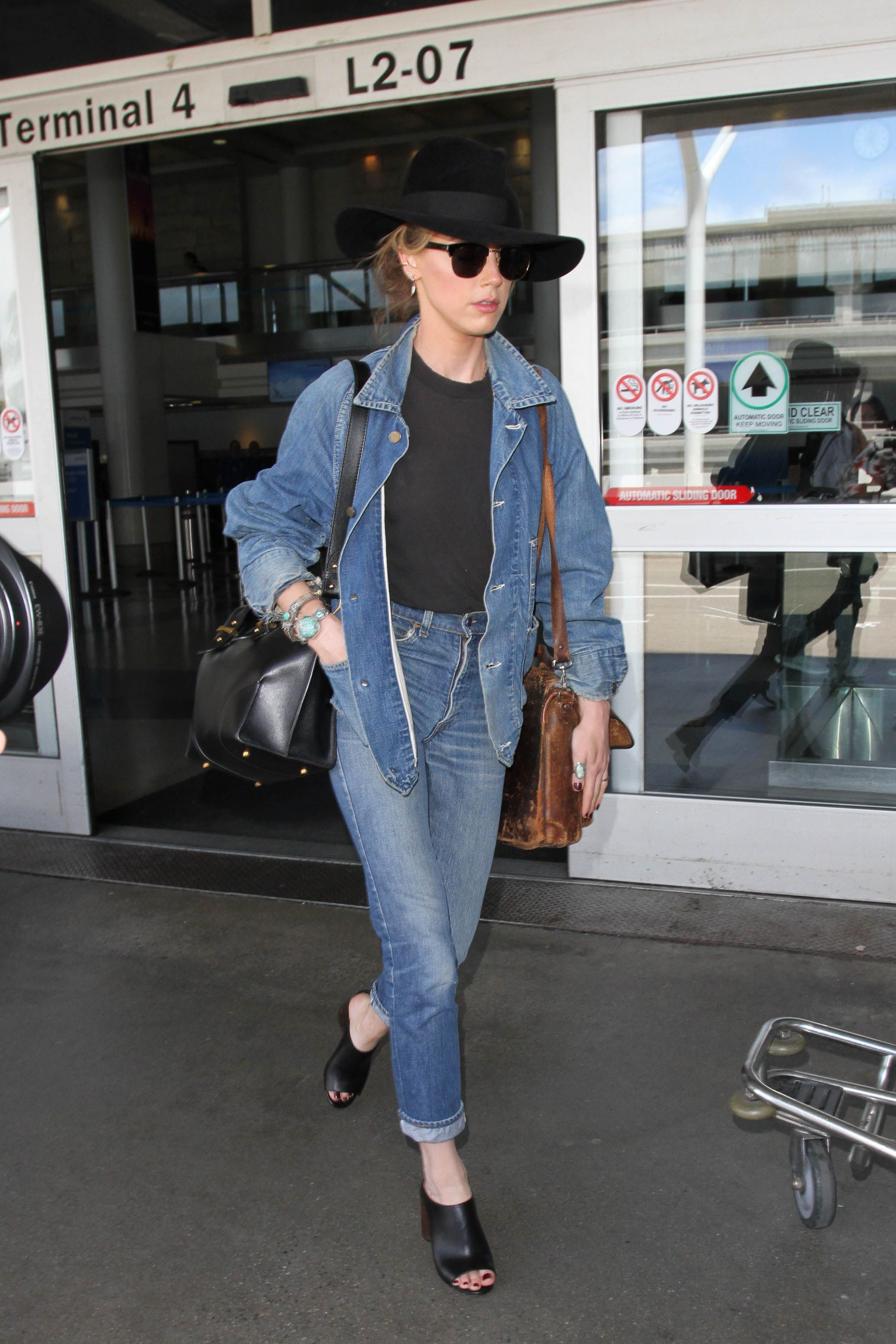 b682a76e207 105 Celebrities Looking Chic at the Airport—in Clothes You d Actually Want  to Wear
