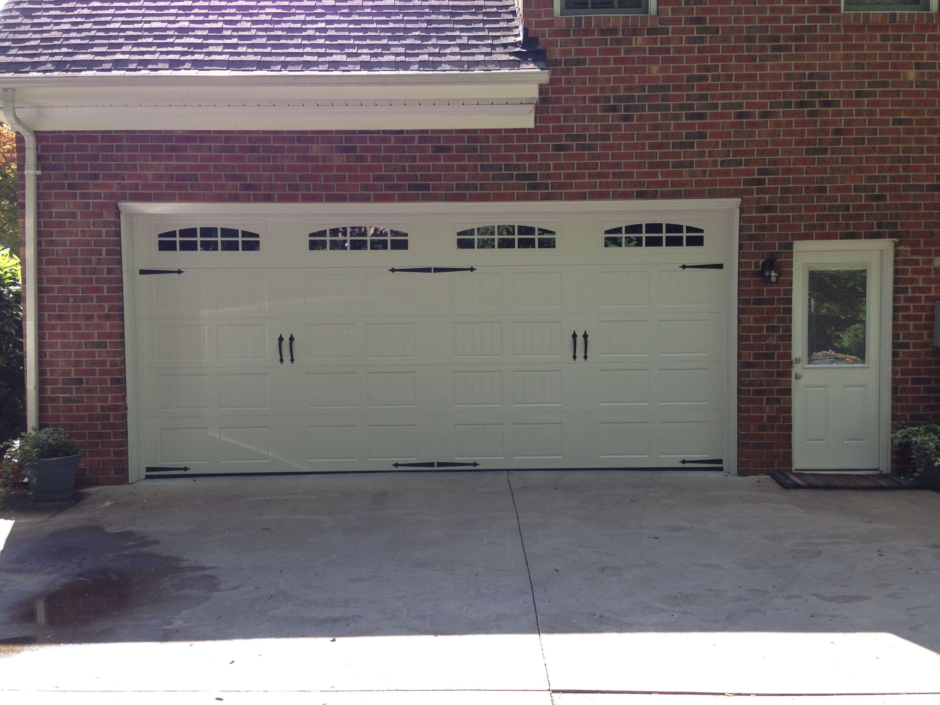 Steel Carriage House Garage Door With Arched Windows And