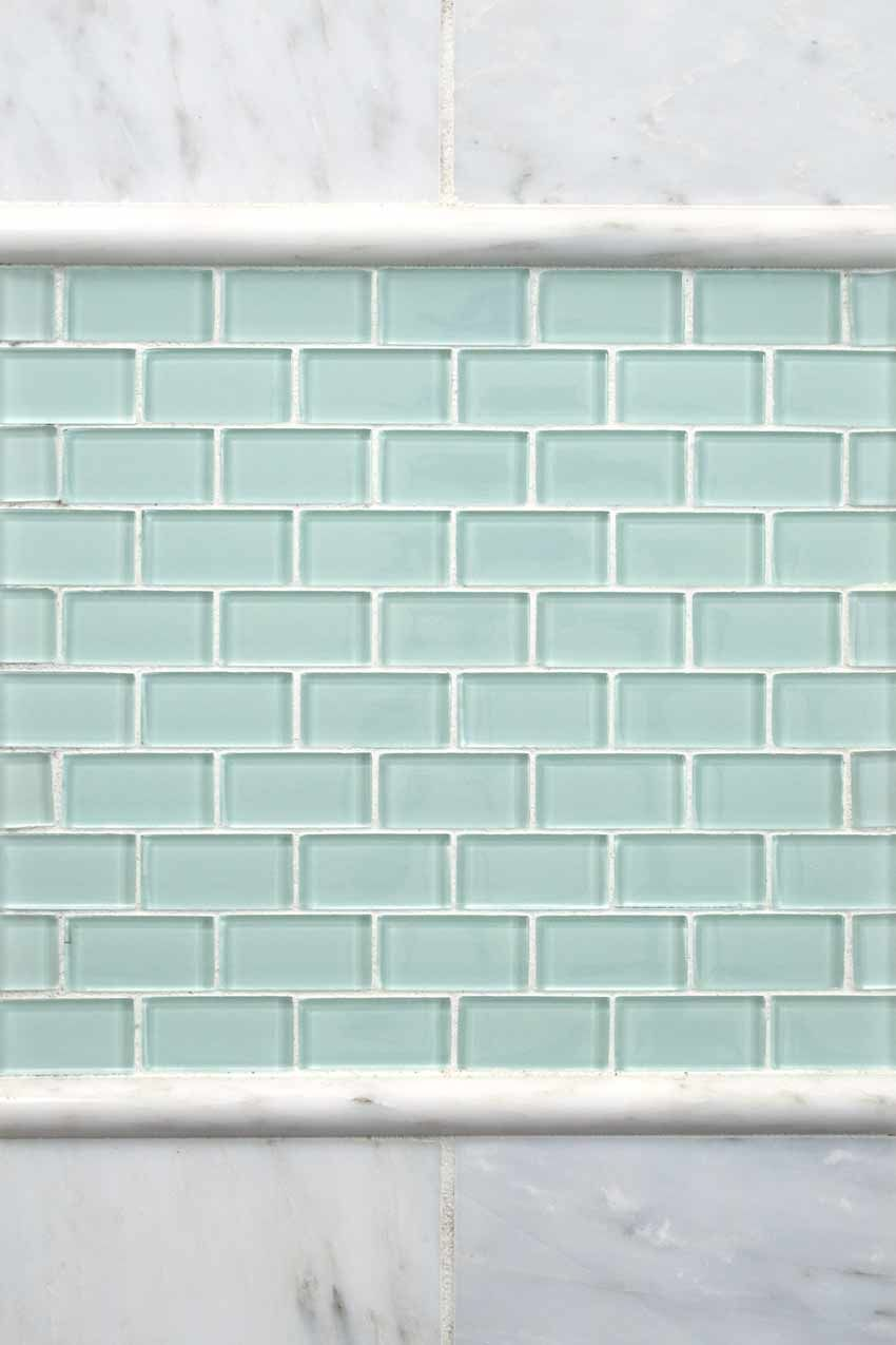 Put A Border Of Mosaics Between Marble Trim Pieces To