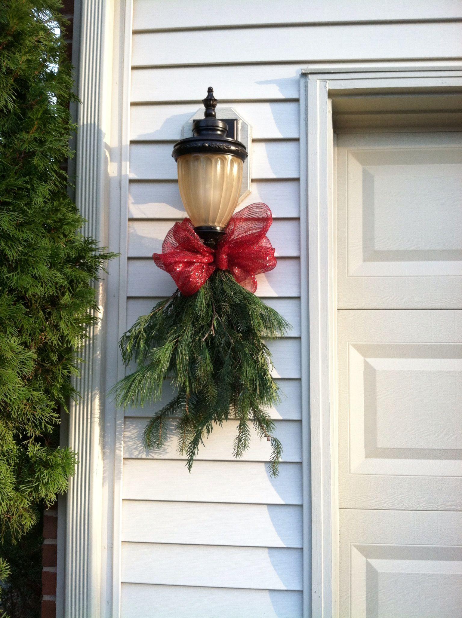 Garage Light Swags Outside Christmas Decorations Decorating With Christmas Lights Christmas Swags