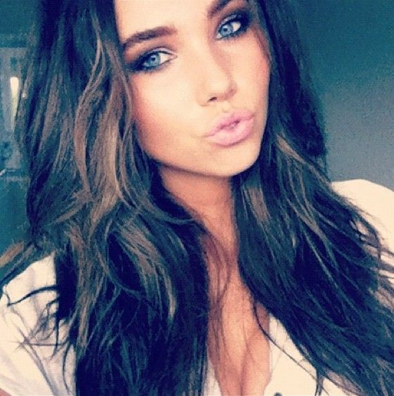 pretty brunette with green eyes