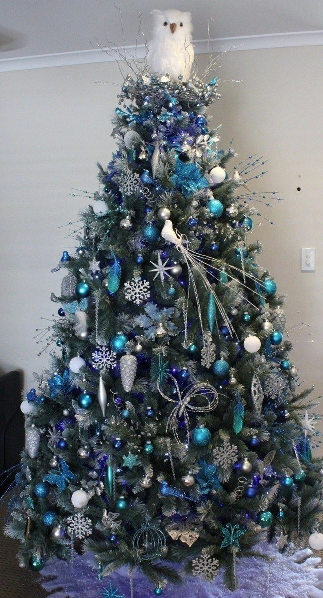 blue christmas tree with owl topper the different shades of warm to bright blues along with the owl tree topper make this tree feel like being in the woods - Blue Christmas Trees