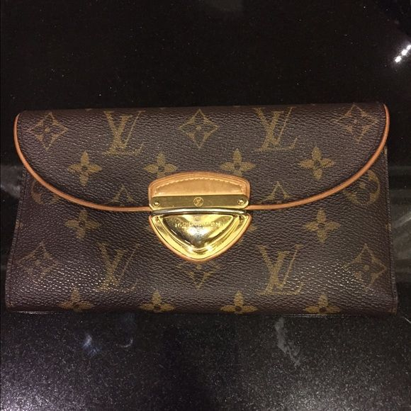 Authentic Louis Vuitton Eugene Wallet Only selling because I sold my purse in this pattern! Bought at Saks Fifth Avenue in San Antonio 6 years ago. Paid $1200. Gold on wallet is scratched some and a little discolored. Inside of wallet is in perfect condition except some marks on clear slot for drivers license. Sides of wallet are in perfect condition. Code inside is MI3097. I do not have receipt or dust bag. $390 on merc. Louis Vuitton Bags Wallets