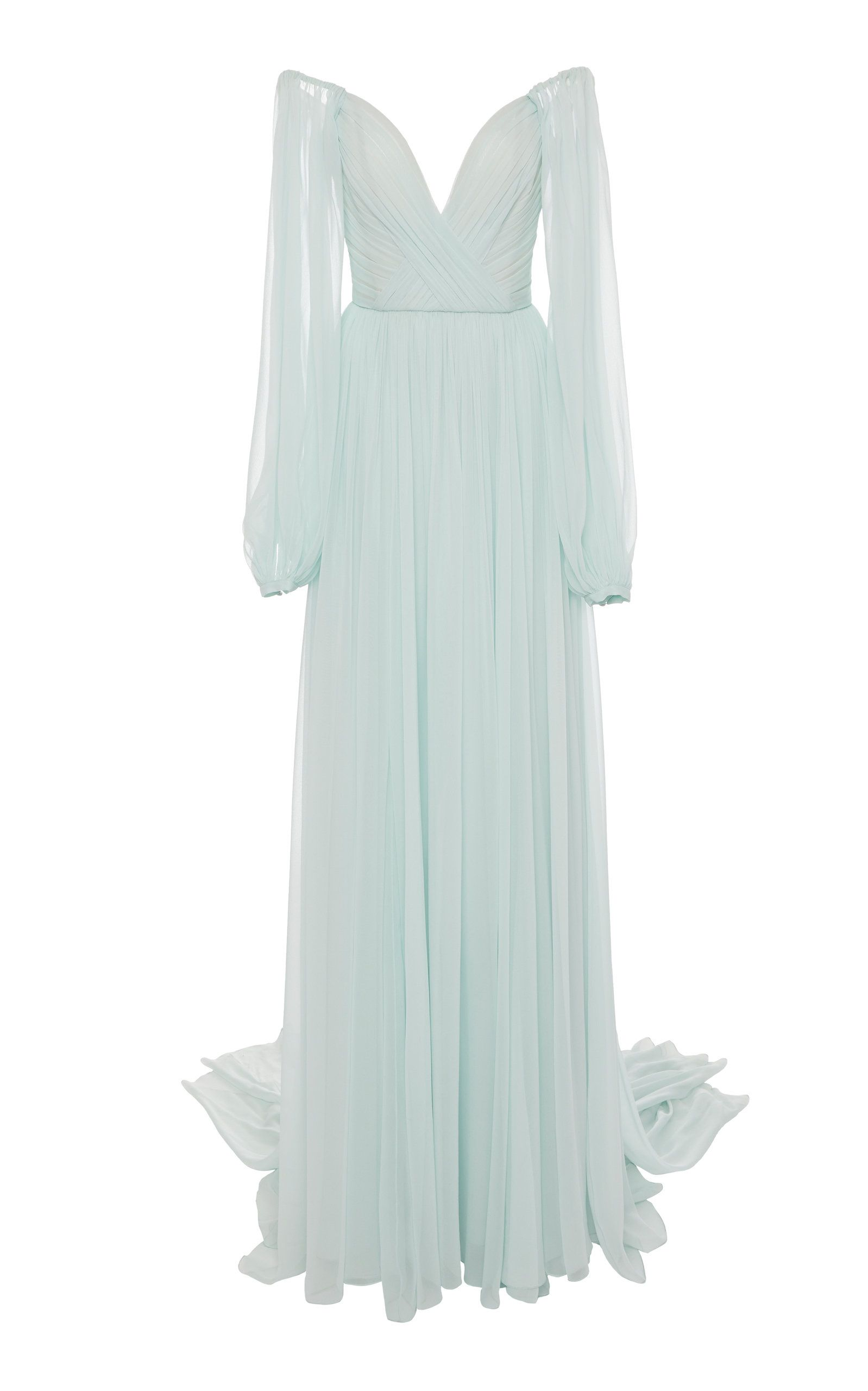 Monique Lhuillier's ethereal gown is something out of a fairytale—it's designed from wispy silk-chiffon that floats so elegantly as you walk. Designed with a plunging sweetheart neckline, it's complete with a relaxed skirt that falls to a slight train. Your look is complete with a metallic clutch and heeled sandals.