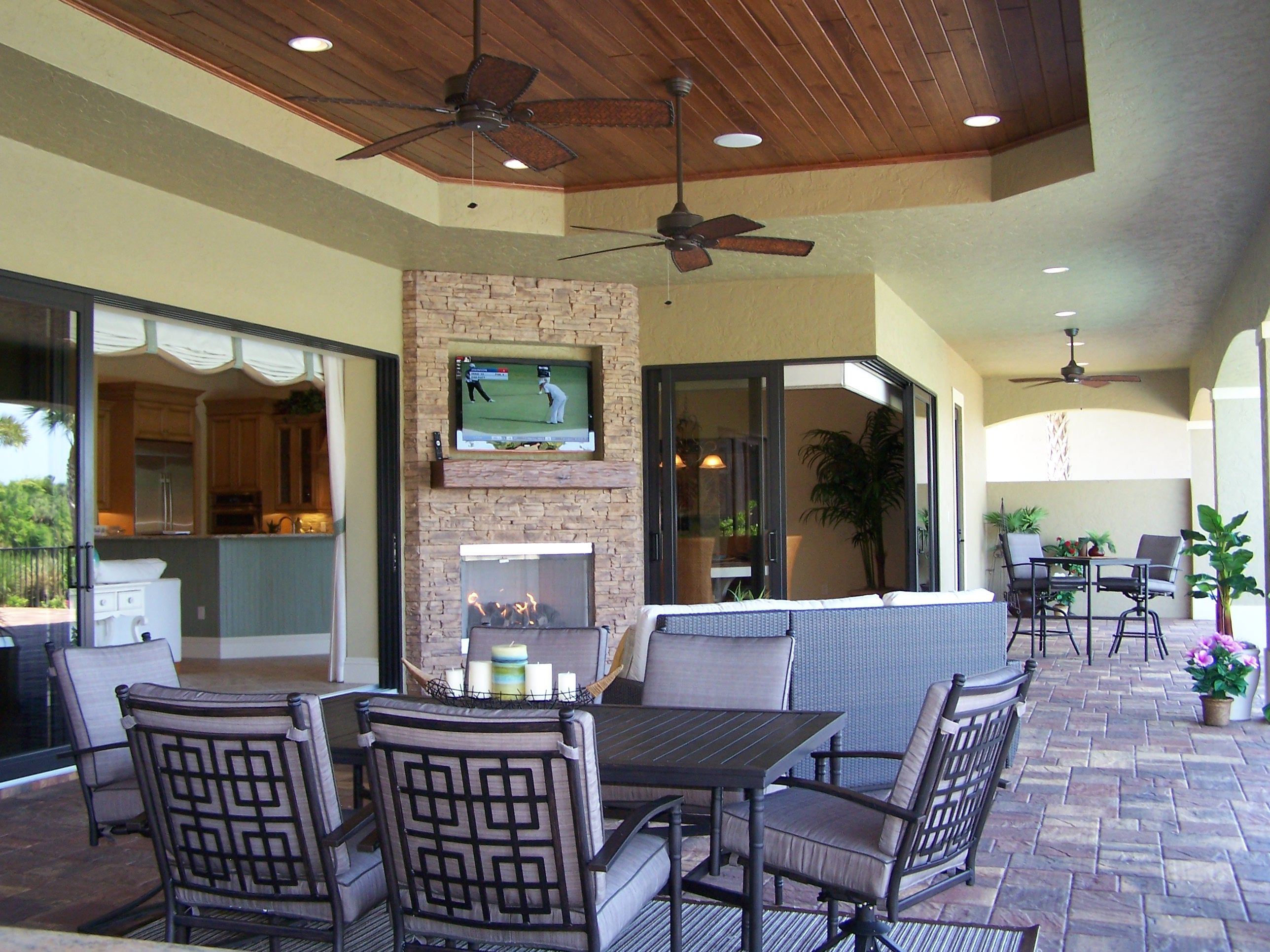 great room designer island kitchen outdoor living room expansive lanai outdoor living rooms on outdoor kitchen and living space id=76295