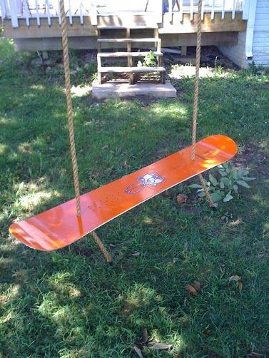 Re-purpose Your Ski Gear: Snowboard swing - Love this for my old snowboards over the years