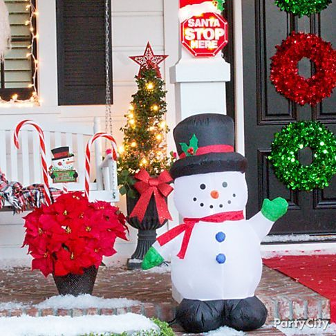 light up your porch with inflatable figures like this snowman holidays christmas. Black Bedroom Furniture Sets. Home Design Ideas