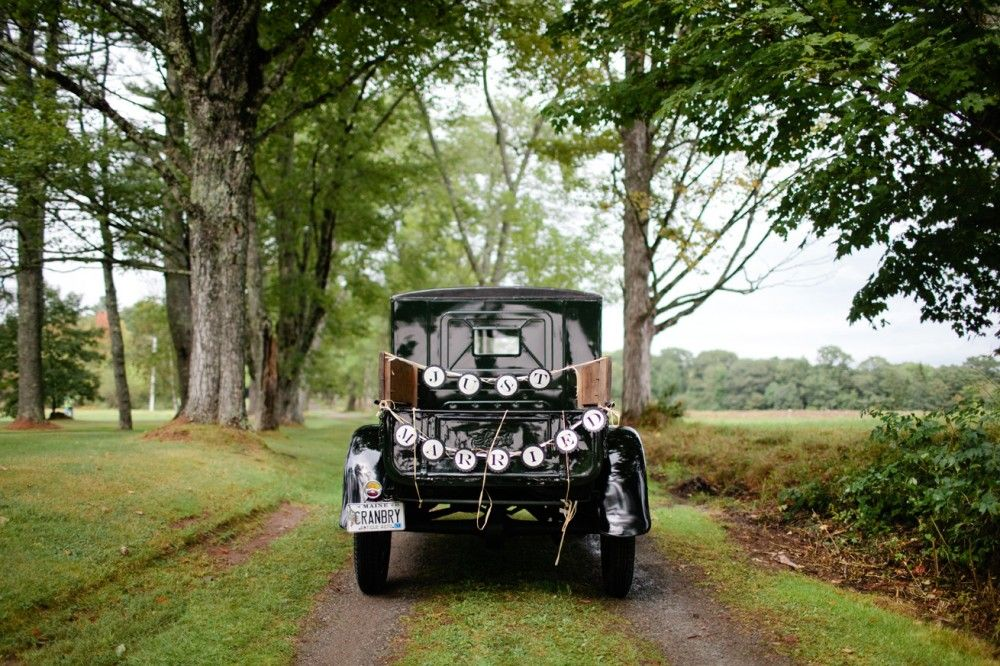 This cool antique car was spotted at a wedding in Waldoboro. Photo by Meredith Perdue. www.realmaineweddings.com
