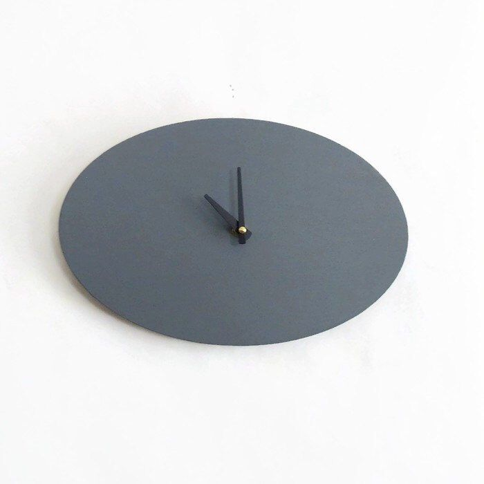 This modern wall clock is one of a kind and ready to ship!