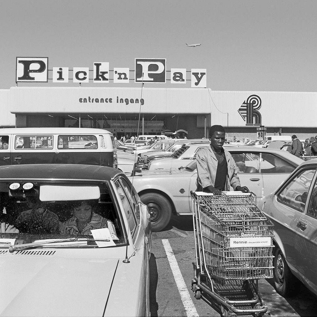 Hypermarket employee collecting trolleys, Boksburg, 1980  David Goldblatt