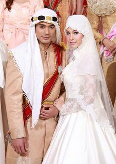 A Man And Women Dressed In Traditional Islamic Wedding Attire