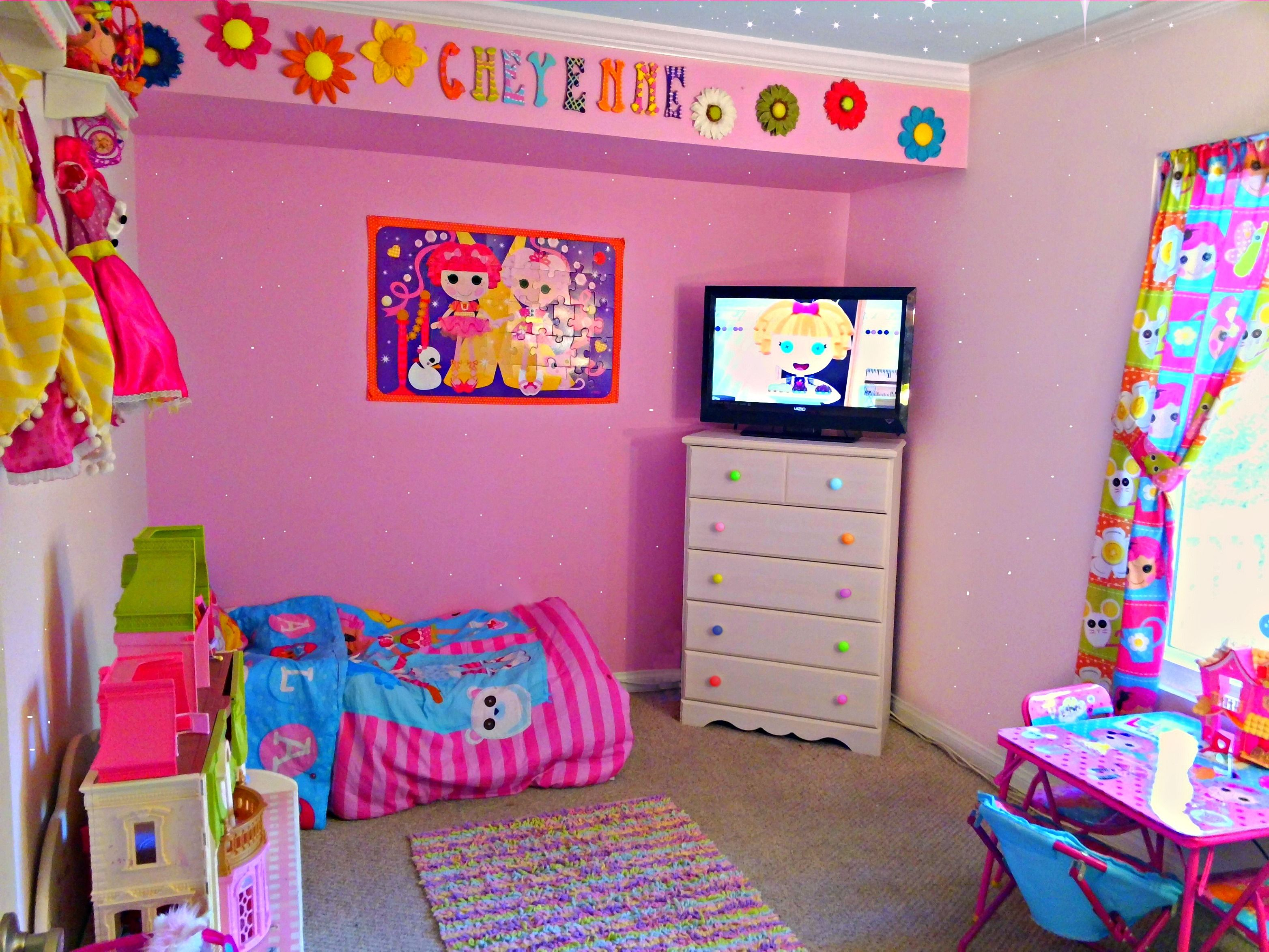 Cheyennes Lalaloopsy room with pink glitter wall and ceiling