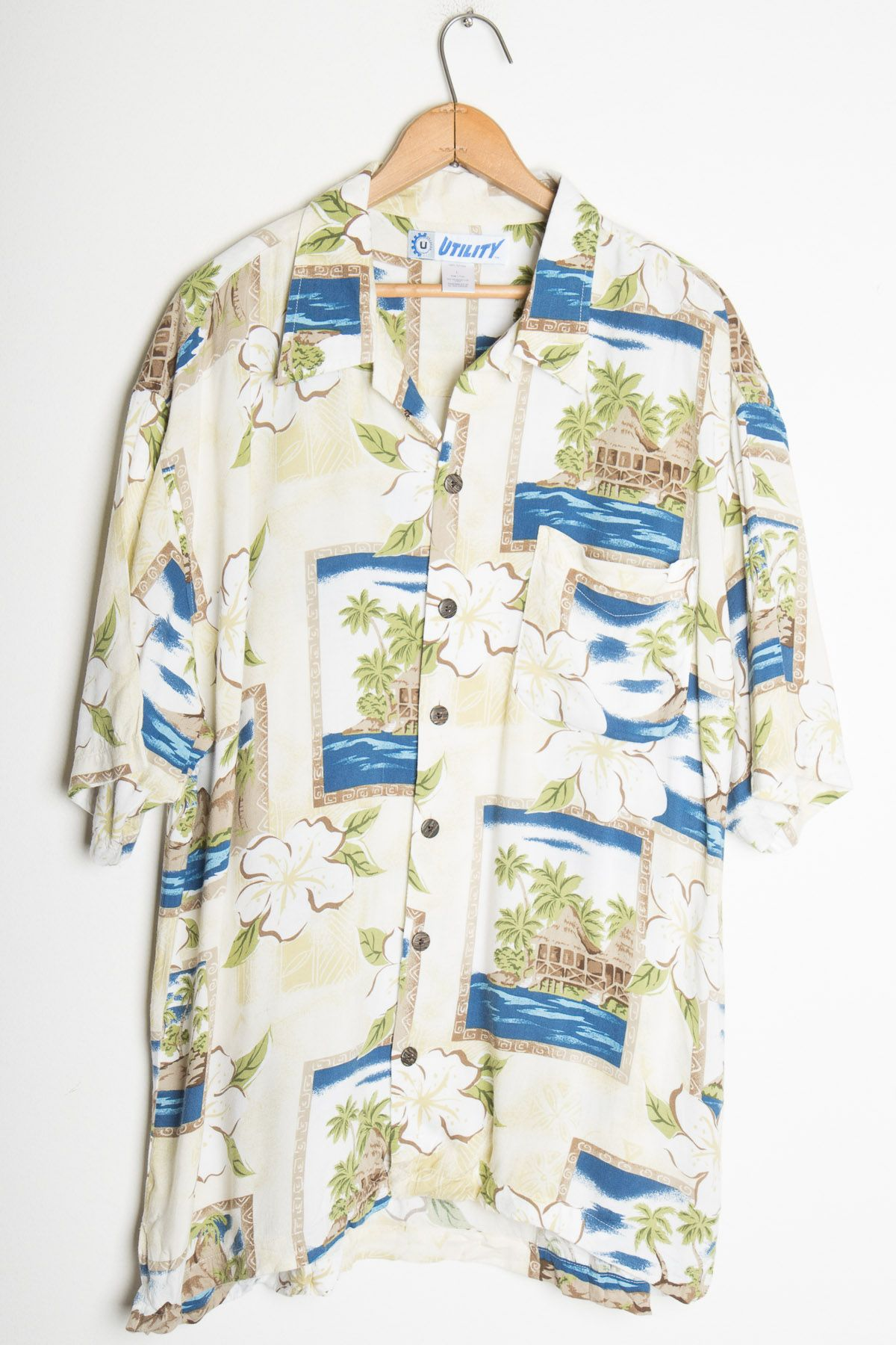 0d866621 Not every hawaiian shirt has to have flashy bright colors. Maybe this laid  back shirt is just what you need!