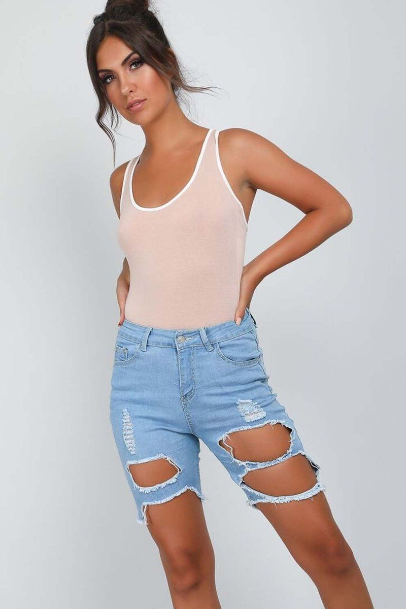 712d32094 PIA RIPPED CYCLING SHORTS £23.00 Step into the new season in style in the  Pia Light Wash Denim Shorts. Featuring anextreme ripped detail and cut off  jean ...