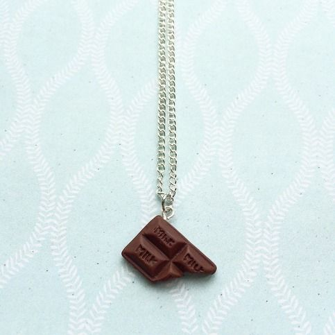 A simple yet yummy looking piece of chocolate that has a bite taken out of it! Be careful not to eat it for real though!  Chocolate bar is hand sculpted with polymer clay. Then attached to a silver plated chain.  Chocolate bar measures 2x1.4cm roughly.  Chain length is 18 inches with a 1 inc...