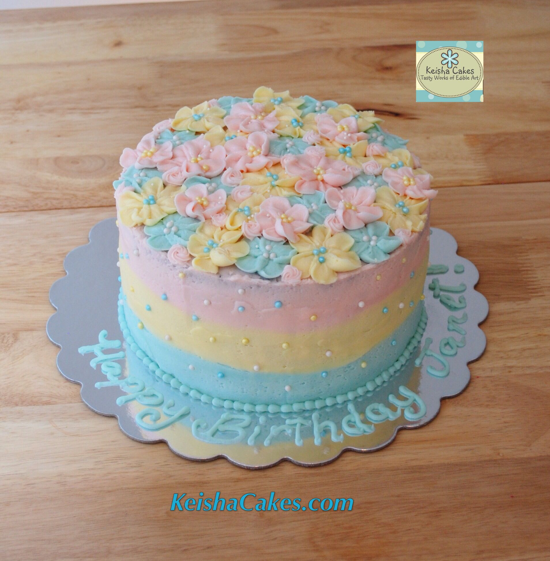 Pastel frosting flowers cake light pink yellow and baby blue used pastel frosting flowers cake light pink yellow and baby blue used made with buttercream frosting and pearl sprinkles on top great for a woman or girls mightylinksfo