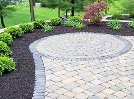 patio paver design ideas love the contrast of the rocks that edge with the pavers - Patio Brick Designs
