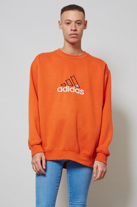 Classic vintage orange sweater in cotton fabric by Adidas. Features Adidas  logo at the front.
