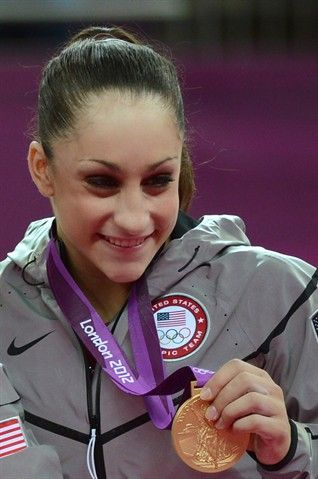 Fresh Faces: U.S. Women Gymnasts - Gymnastics Slideshows   US gymnast Jordyn Wieber celebrates with the gold medal on the podium of the women's team final artistic gymnastics event.   (Photo: Emmanuel Dunand / Getty Images) #NBCOlympics