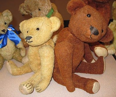 """A couple of very rare American bears from around 1907-1908: on the left, a teddy made by the Miller Mfg. Co., advertised as an """"antiseptic, hygenic"""" toy; and on the right, a cinnamon colored bear from Hahn & Amberg. Both bears are made of a wooly fabric and, unusually, stuffed with cork."""